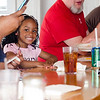 Nzyiah Adams, 4, enjoys some lunch at William's Southern Soul, owned by William Marks, during a grand opening on Thursday afternoon. SENTINEL & ENTERPRISE / Ashley Green