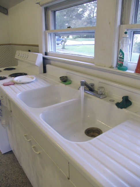 Large sink with built in drain boards, water on and running with great pressure.