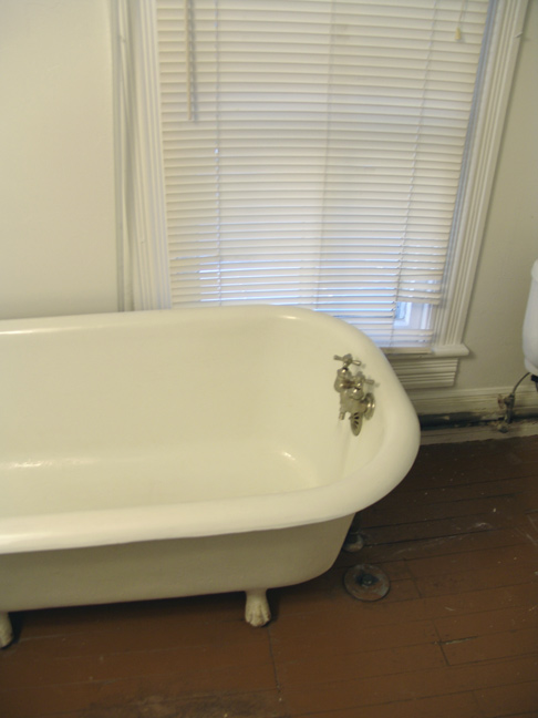 View of Tub and Heart of Pine Floors.