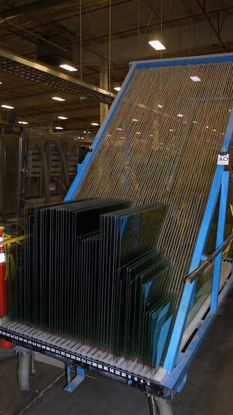 This is how the glass is moved around after cutting.  Note that the sheets lean on an angle so that the shelves don't touch the soft-coat low-E.