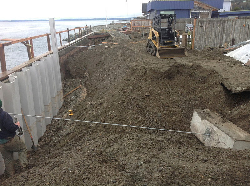 "The anchoring system. Sound Slope employed 3/4"" diameter galvanized Coil rod and 3,500 pound concrete blocks as the anchoring system. The anchor blocks are 20 feet landward of the seawall."