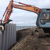 A vibratory hoe pack was used to install the vinyl sheet piling.