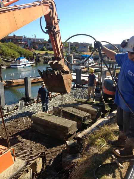 Preparing the concrete anchor blocks for drilling.