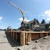Completed plank and piling seawall.