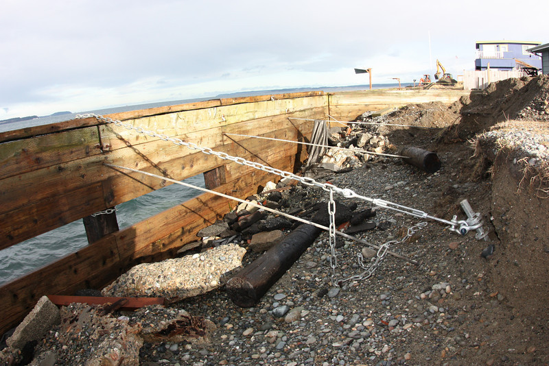 Some sections of the seawall suffered more than others. Sound Slope employed helical anchors to secure the seawall during the repair.<br /> The original tie backs were insufficient, toxic creosote telephone poles, 4 tons of creosote treated wood was removed from the site.