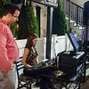Wendy Limbaugh shows Sentinel & Enterprise reporter Jon Bishop how to work the karaoke table at the Bootlegger in Lunenburg on Thursday evening. SENTINEL & ENTERPRISE / Ashley Green