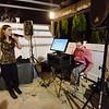 Sentinel & Enterprise reporter Jon Bishop works the karaoke table as Wendy Limbaugh sings at the Bootlegger in Lunenburg on Thursday evening. SENTINEL & ENTERPRISE / Ashley Green