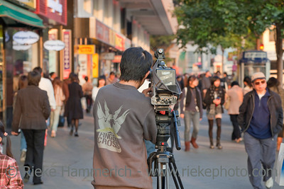 TV Reporter shooting Street Scene - Reality TV in Hong Kong, China
