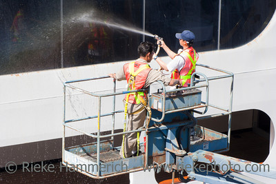 Vancouver, British Columbia, Canada – August 6, 2005: Two Window Washers cleaning the Windows of a Cruise Ship in Vancouver, Canada. The Cruise Ship is docked on Canada Place, the main cruise ship terminal for the region with more than 570.000 passengers on 177 sailings during a year.