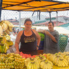 SAN JOSE, COSTA RICA - AUGUST 31: Market Vendors selling bananas in San Jose, Costa Rica on August 31, 2008. Farmer's markets are a traditional way of selling agricultural products