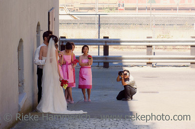 Vancouver, British Columbia, Canada – August 6, 2005: Wedding Photographer taking picture of bride, and groom in Gastown, Vancouver, Canada. Gastown is a national historic site of Canada and a popular tourist attraction with restaurants, nightclubs and fashion boutiques.