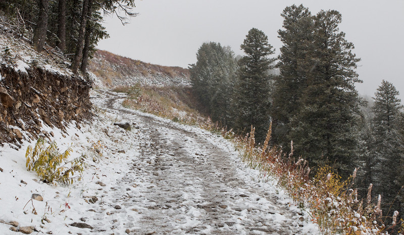 Snow starts to fall near top of chair lift on Snow King Mountain