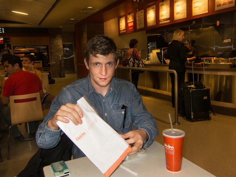 John and his giant burrito at Salt Lake City Airport