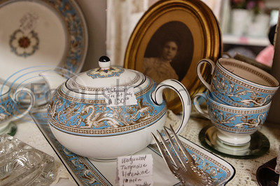 Vintage tea pots and dining utensils are for sale at Ye Olde City Antique Mall in downtown Tyler, which on reopened in new sections of an adjacent building on Monday after a devastating fire on June 2.