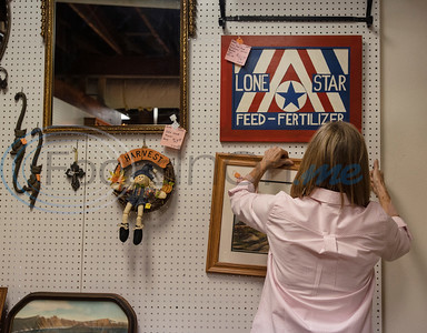 Susy Smith helps hang items at Donna Bray's booth at Ye Olde City Antique Mall in downtown Tyler on Wednesday, Sept. 23, 2020. The antique store reopened in new sections of an adjacent building on Monday after a devastating fire on June 2.