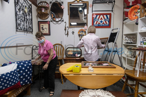 Antique booth operator Donna Bray of Jacksonville and her friend Susy Smith put together Bray's booth at Ye Olde City Antique Mall in downtown Tyler on Wednesday, Sept. 23, 2020. The antique store reopened in new sections of an adjacent building on Monday after a devastating fire on June 2.