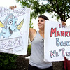 Emily Fortier, 23, of Fitchburg who works at the Market Basket in Leominster was out with signs in front of the store on Monday afternoon. SENTINEL & ENTERPRISE/JOHN LOVE