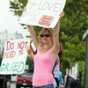Erica Cutting, 23, Fitchburg who works at the Market Basket on Water Street in Fitchburg was out with signs in front of the store on Monday afternoon. SENTINEL & ENTERPRISE/JOHN LOVE