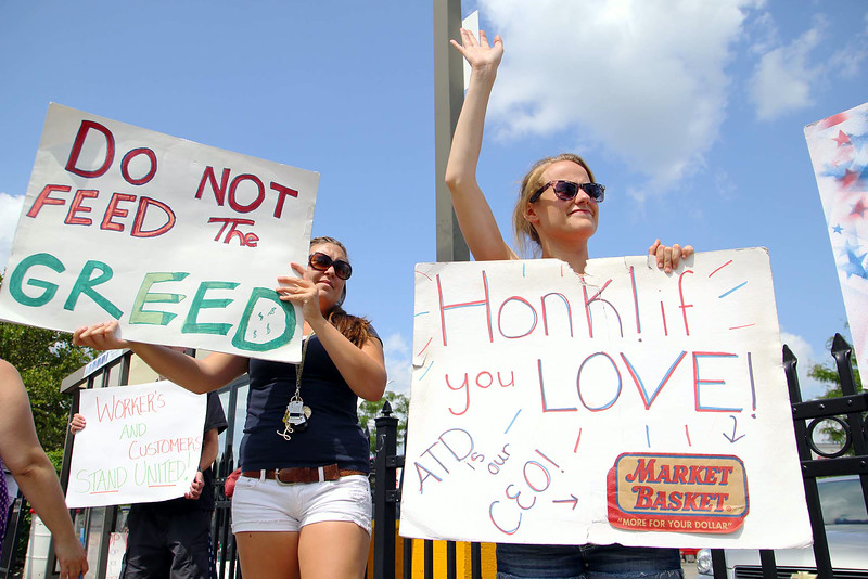 Laura Simmons, 20, of Fitchburg and Erica Cutting, 23, of Fitchburg who work at the Market Basket on Water Street in Fitchburg were out with signs in front of the store on Monday afternoon. SENTINEL & ENTERPRISE/JOHN LOVE