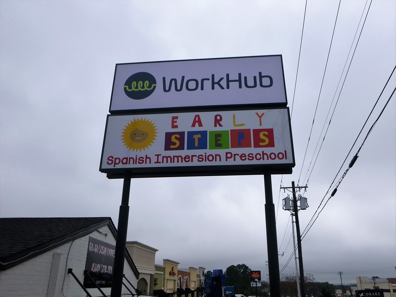 Work Hub and Early Steps Double Pole Sign