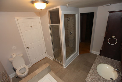 Unit #3:  bathroom, 2 sinks,  built- in custom cabinets, walk-in shower, spa tub,  guest entrance from commons area and a private bedroom entrance