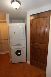 washer and dryer included in unit door to the right is private entrance to bathroom
