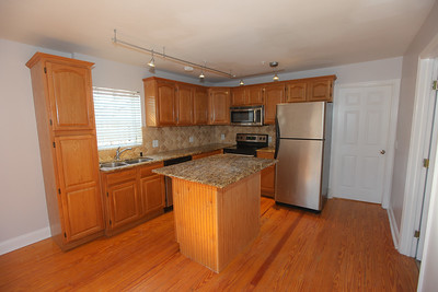 Unit #3 Kitchen with dishwasher and island
