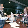 The GazBar Restaurant in Leominster was still serving takeout during the coronavirus emergency on Wednesday, March 18, 2020. Kristen Mills gives Tony Fields, owner of Cleartech Group in Leominster, his takeout order.  SENTINEL & ENTERPRISE/JOHN LOVE