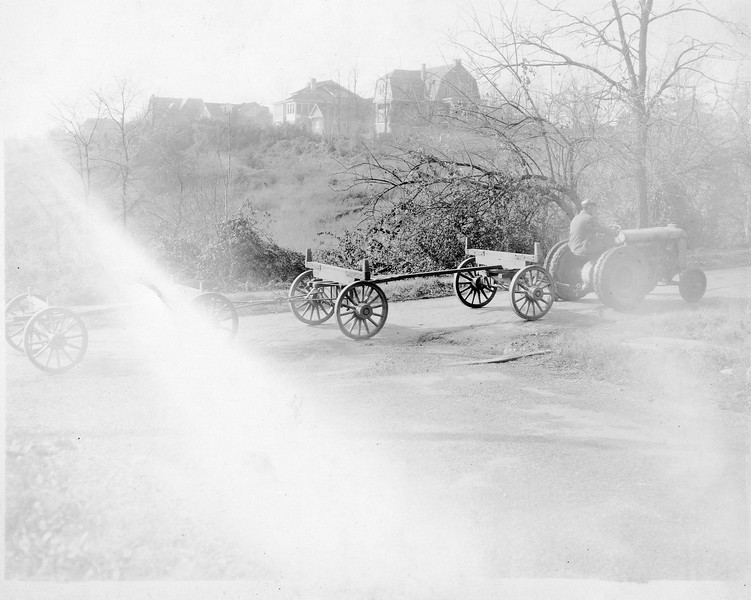 Wagon chassis being towed by a tractor (03157)