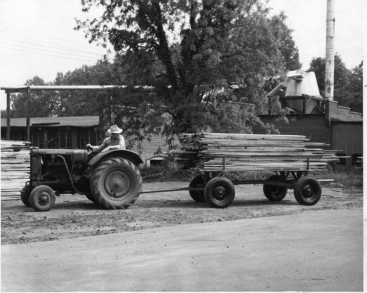 A Tractor Transporting a load of lumber to Thornhill Wagon Company (03105)