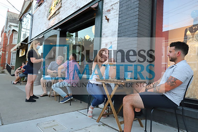 Steve Fortunato (right) and Lauren Hopkins sit for drinks outside of ShuBrew in Zelienople Saturday. Seb Foltz/Butler Eagle  06/20/20