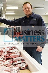 Nick Rath, Sales and Marketing Manager for Rath Farms holds a brisket.
