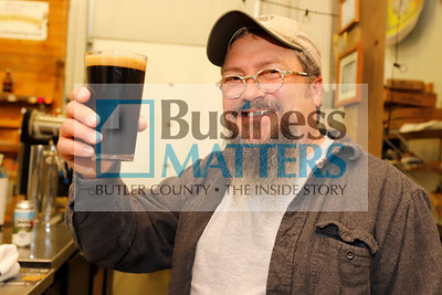 North Country Brewing Co. owner Bob McCafferty raises a glass of the brewery's Buck Snort Stout. Seb Foltz/Butler Eagle Sept. 2020