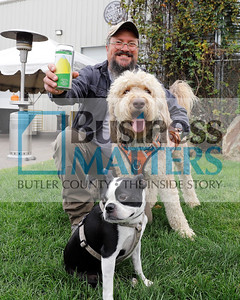 North Country Brewing Co. owner Bob McCafferty, his golden doodle Finn, and an employees dog. (Need to check name Bruce Wayne, I think). Seb Foltz/Butler Eagle