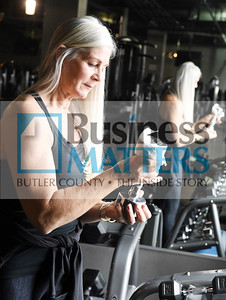Sharon Puluso of the Training Center in Mars cleans the dumb bells in her private gym. Harold Aughton/Butler Eagle.
