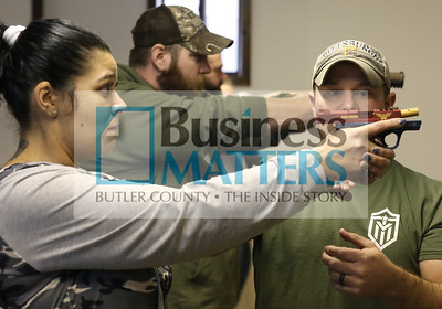 Mike Dunlap of Trigger Mike's Firearms Training helps Stephanie Alexander of West Sunbury with her hand position during a gun safety class at the Buffalo Sportsman Club. Seb Foltz/Butler Eagle 01/09/20