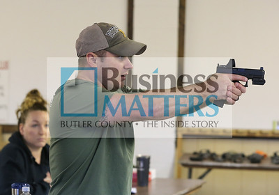 Mike Dunlap of Trigger Mike's Firearms Training demonstrates proper stance during a gun safety class at the Buffalo Sportsman Club. Seb Foltz/Butler Eagle 01/09/20