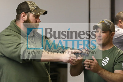 Mike Dunlap of Trigger Mike's Firearms Training explains proper hand position to Dan Bunyan of West Sunbury during a gun safety class at the Buffalo Sportsman Club. Seb Foltz/Butler Eagle 01/09/20