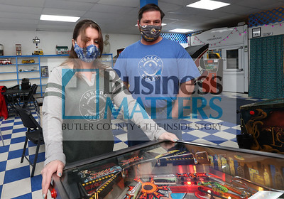 Tokens Arcade owners Brandy and Chris Henry play pinball at their business in Lyndora. Seb Foltz/Butler Eagle 01/27/21