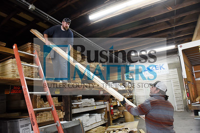 Phil Rudolph and Harry Siebert of Dambach Lumber and Supply load a truck full of lumber for delivery. Harold Aughton/Butler Eagle.