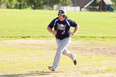 Saxonburg's #27 heads for third base in Tuesday's game against Karns City. Seb Foltz/Butler Eagle