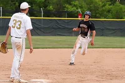 Cranberry's Seve Balog rounds third on his way to scoring against Butler Thursday. Seb Foltz/Butler Eagle