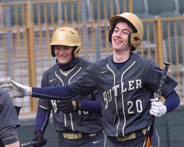 Butler secondbaseman David Leslie celebrates his inside-the-park homerun against Knoch in Friday's home opener. Seb Foltz/Butler Eagle 03/26/21