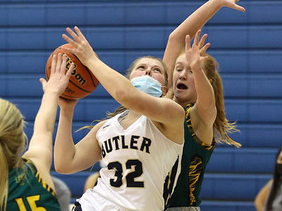 Butler's Maisy Gibson (32) goes for a layup against Penn Trafford's Olivia Pepple(11) Thursday at home. Seb Foltz/Butler Eagle 01/28/21