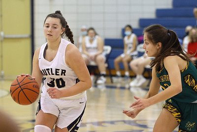 Butler's Makenna Maier(30) drives down  court against Penn Trafford's Lillian Palladino (22) Thursday at home. Seb Foltz/Butler Eagle 01/28/21