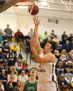 Mars' Michael Carmody hits a  layup against South Fayette. Seb Foltz/Butler Eagle