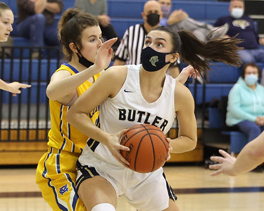 Butler's Alison Altman drives to the hoop for a layup against Canon-McMillan Friday. Seb Foltz/Butler Eagle 02/19/21