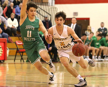 Zach Schlegel of Mars drives the lane against South Fayette's Jake Dunay. Seb Foltz/Butler Eagle