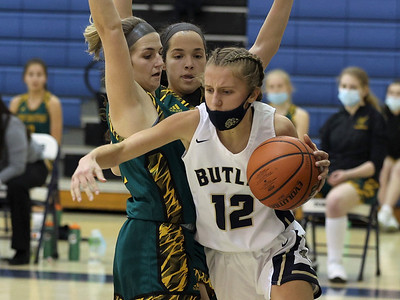 Butler's Samantha Miller gets around a double team for a layup against Penn Trafford. Seb Foltz/Butler Eagle 01/28/21