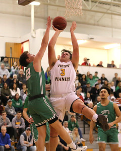 Mars' Michael Carmody extends for a layup against South Fayette's Kade St. Ledger. Seb Foltz/Butler Eagle